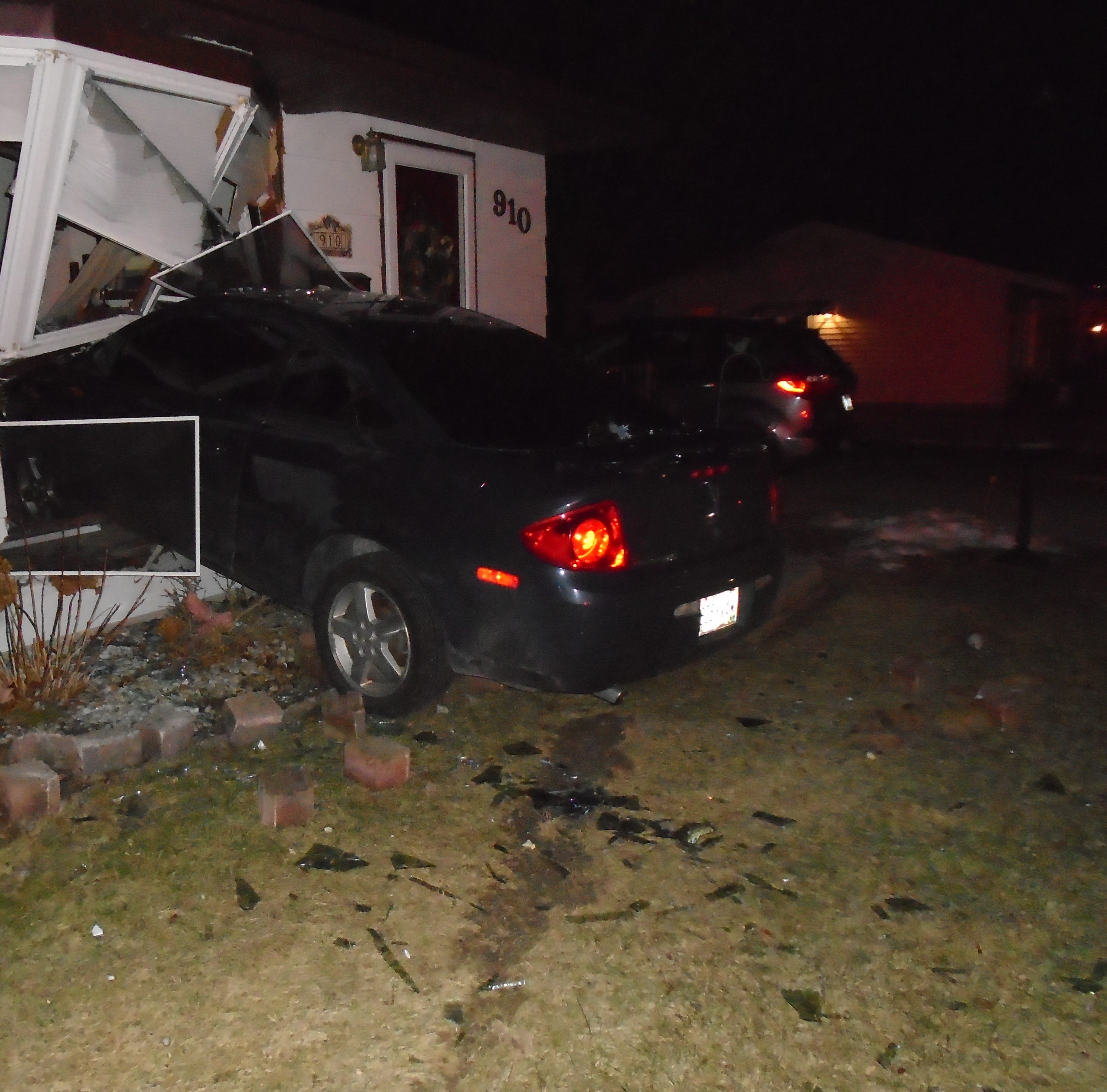 Vehicle crashes into Manitowoc living room, driver arrested, three remain missing