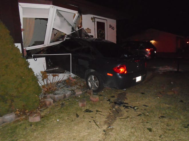 A car crashed into a Manitowoc living room Tuesday night.