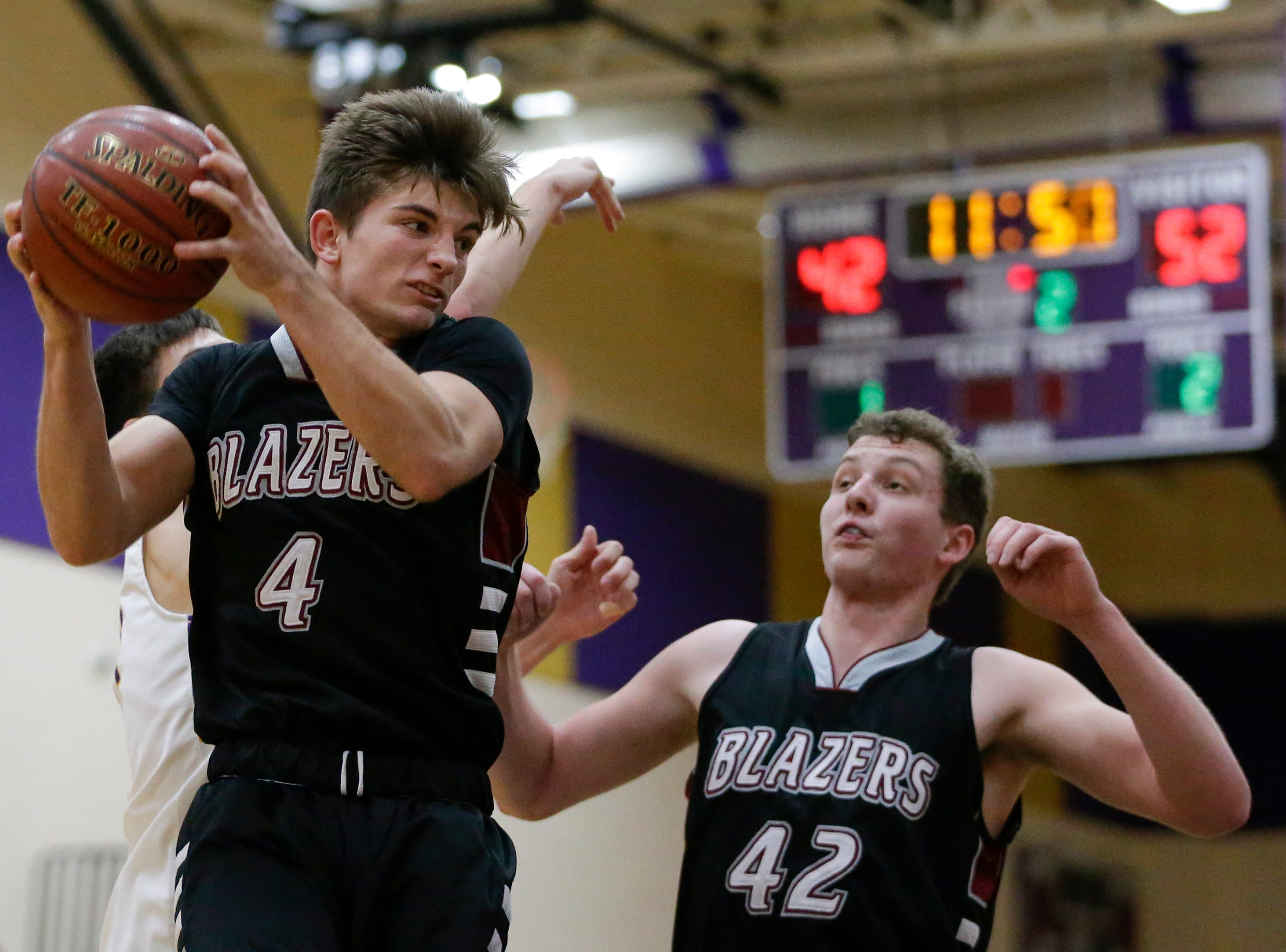 Green Bay NEW Lutheran's Zach Luepke (4) grabs a rebound against Two Rivers at Two Rivers High School Tuesday, January 8, 2019, in Two Rivers, Wis. Joshua Clark/USA TODAY NETWORK-Wisconsin