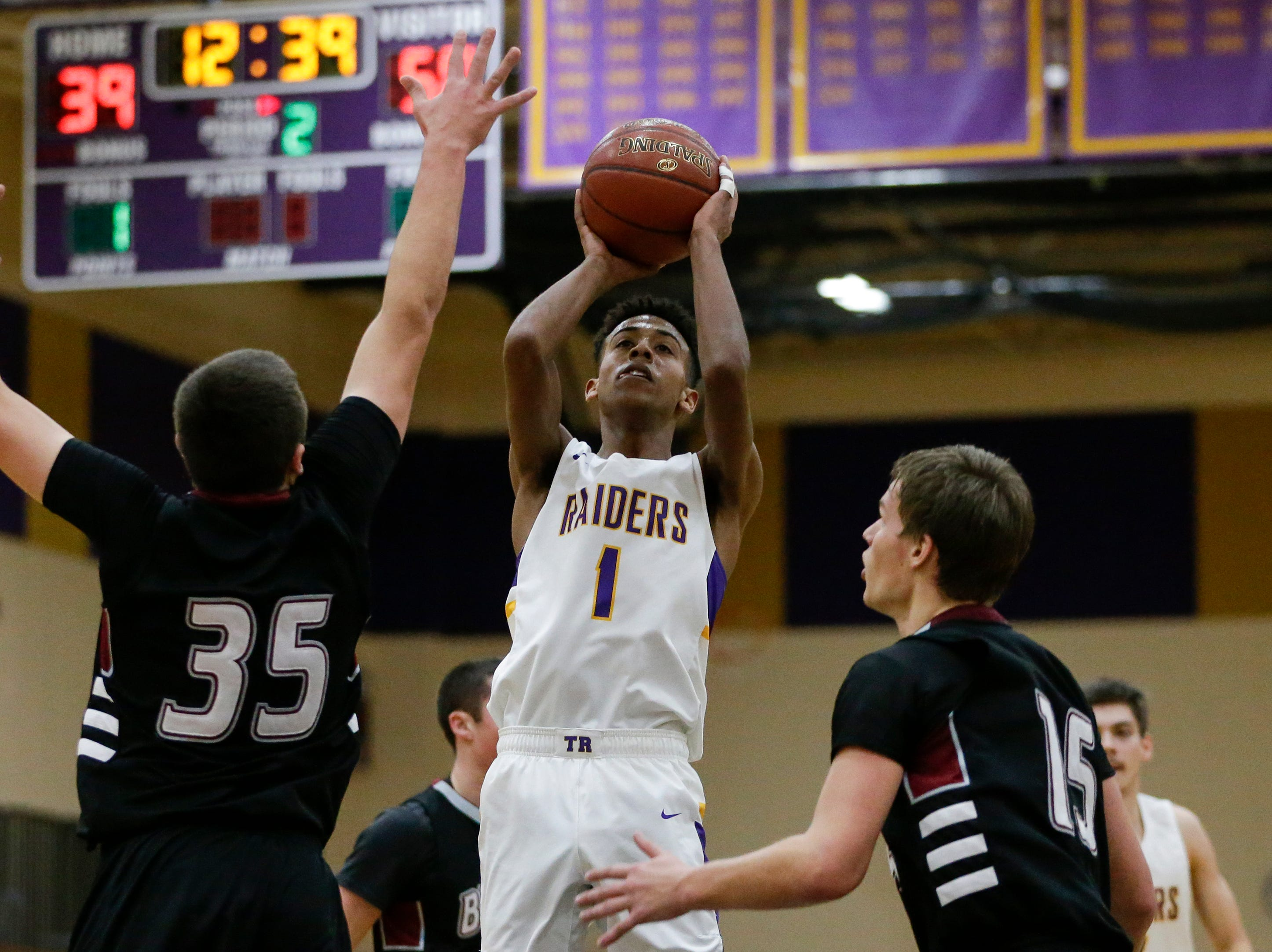 Two Rivers' Isaac Coronado shoots against Green Bay NEW Lutheran at Two Rivers High School Tuesday, January 8, 2019, in Two Rivers, Wis. Joshua Clark/USA TODAY NETWORK-Wisconsin