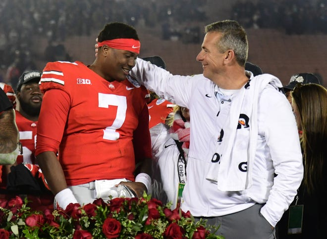 Ohio State coach Urban Meyer shares a celebratory moment with quarterback Dwayne Haskins after the Buckeyes beat Washington in the Rose Bowl 28-23.