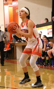 Lucas' Kayla Hignite makes a shot while playing against Temple Christian earlier this season.