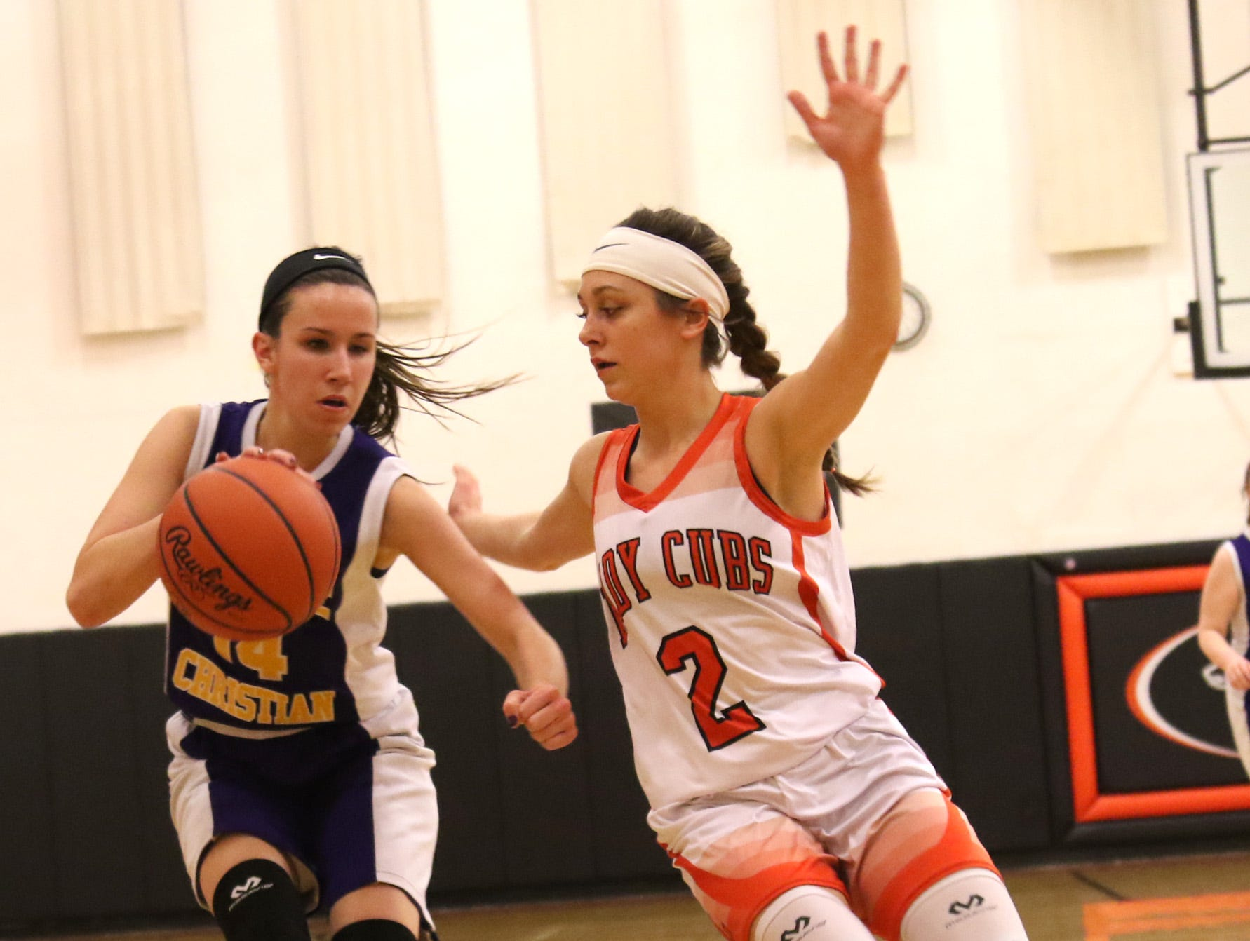 Temple Christian's Jenna Wolford moves the ball while playing at Lucas on Tuesday.