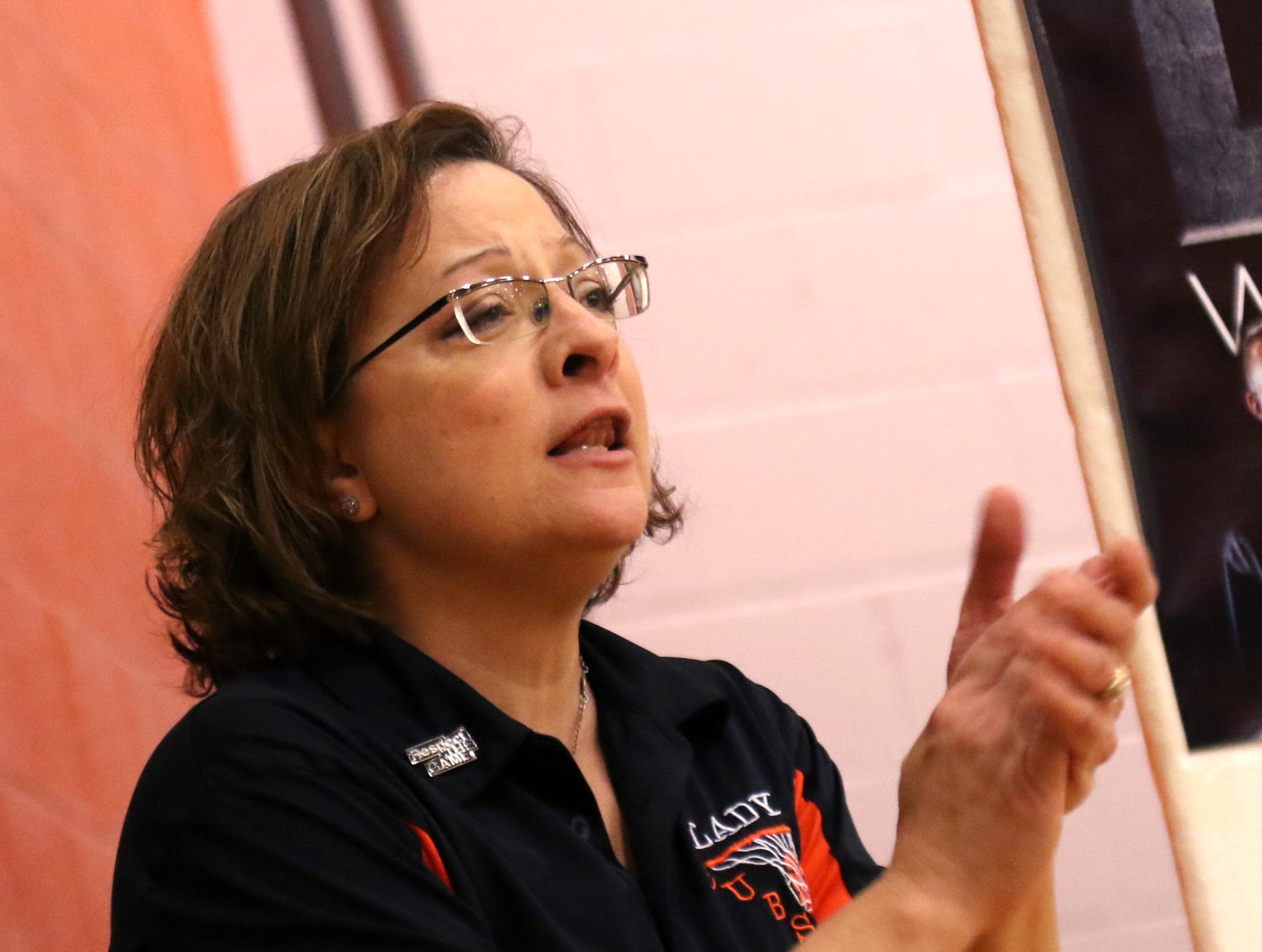 Lucas girls basketball coach Kathy Grover cheers on her team while playing against Temple Christian on Tuesday.