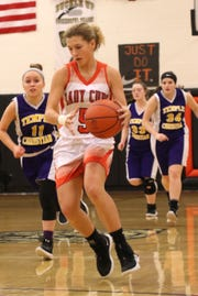 Lucas' Jamie Grover dribbles the ball down the court while playing against Temple Christian on Tuesday.