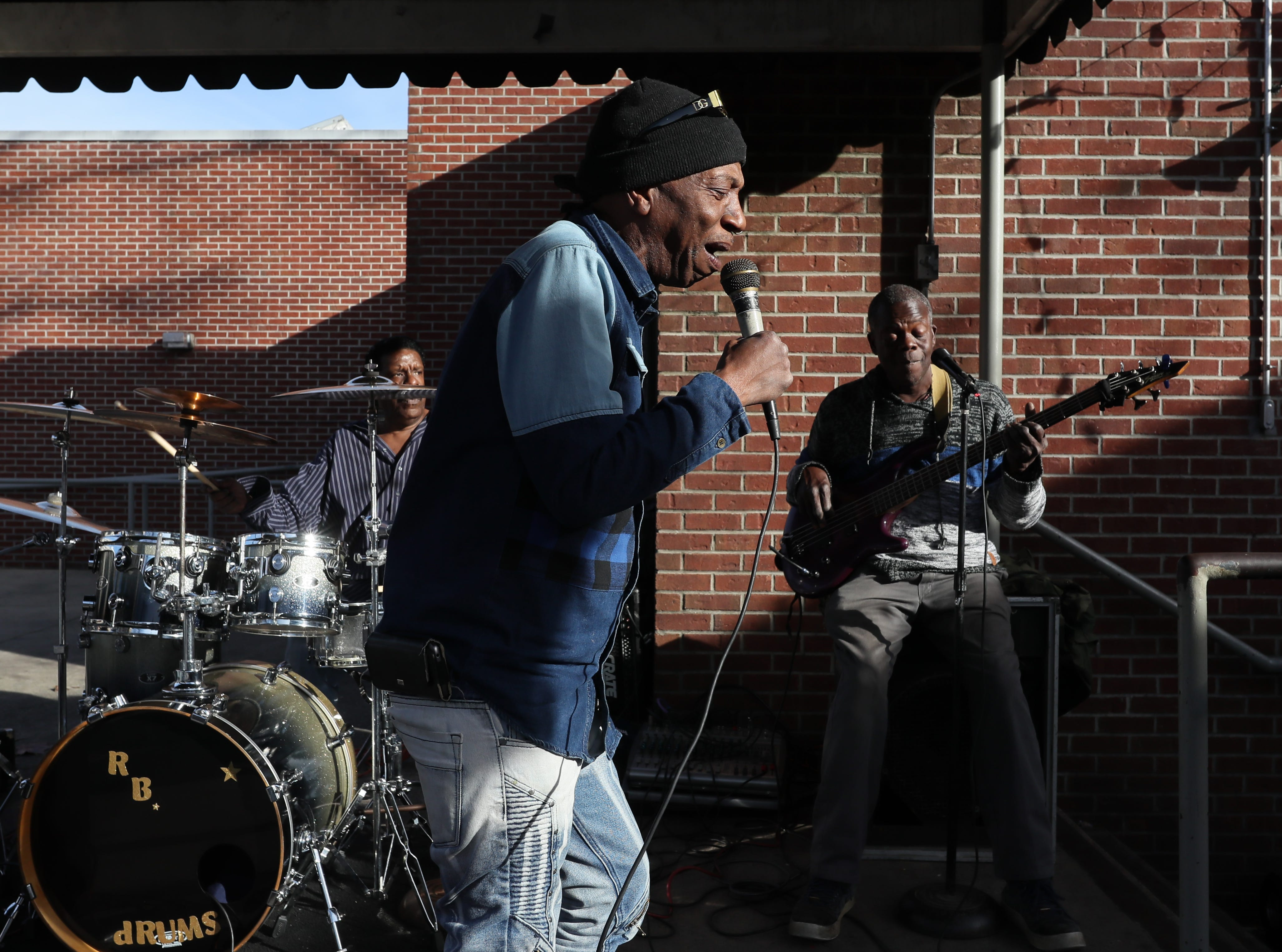 Smokey Joe Partee leads the WQBC band, or 'Wanna Quit But Can't, as they play off Beale Street at Handy Park on a warm winter afternoon Tuesday, Jan. 8, 2019. Temperatures for the day were in the mid-60's, ahead of the coming cool front in store for the remainder of the week.