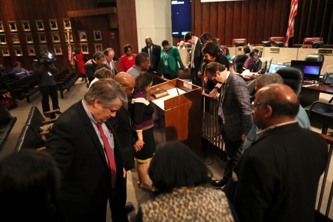 Memphis City Council members gather in prayer after their meeting downtown on Tuesday, Jan. 8, 2019.