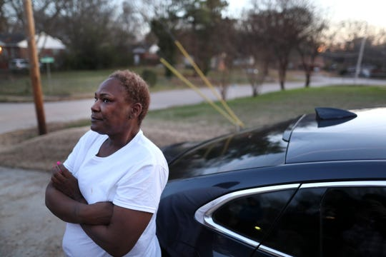 Angela Shears, grandmother of Kennedy Mills, stands outside his home as she recounts the details of the day, she says he and his younger brother were called racial slurs and chased with a gun by their neighbor, Bradley Watkins, 36, after a confrontation at the local Family Dollar store.