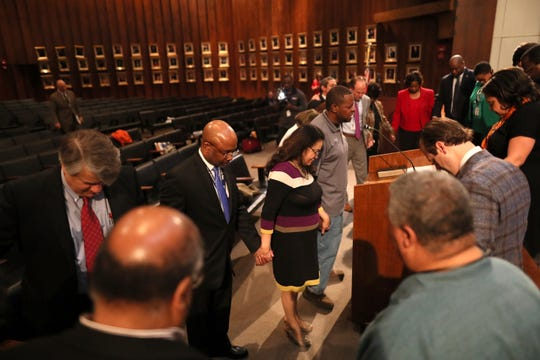 Memphis City Council members gather in prayer after their meeting downtown on Jan. 8.