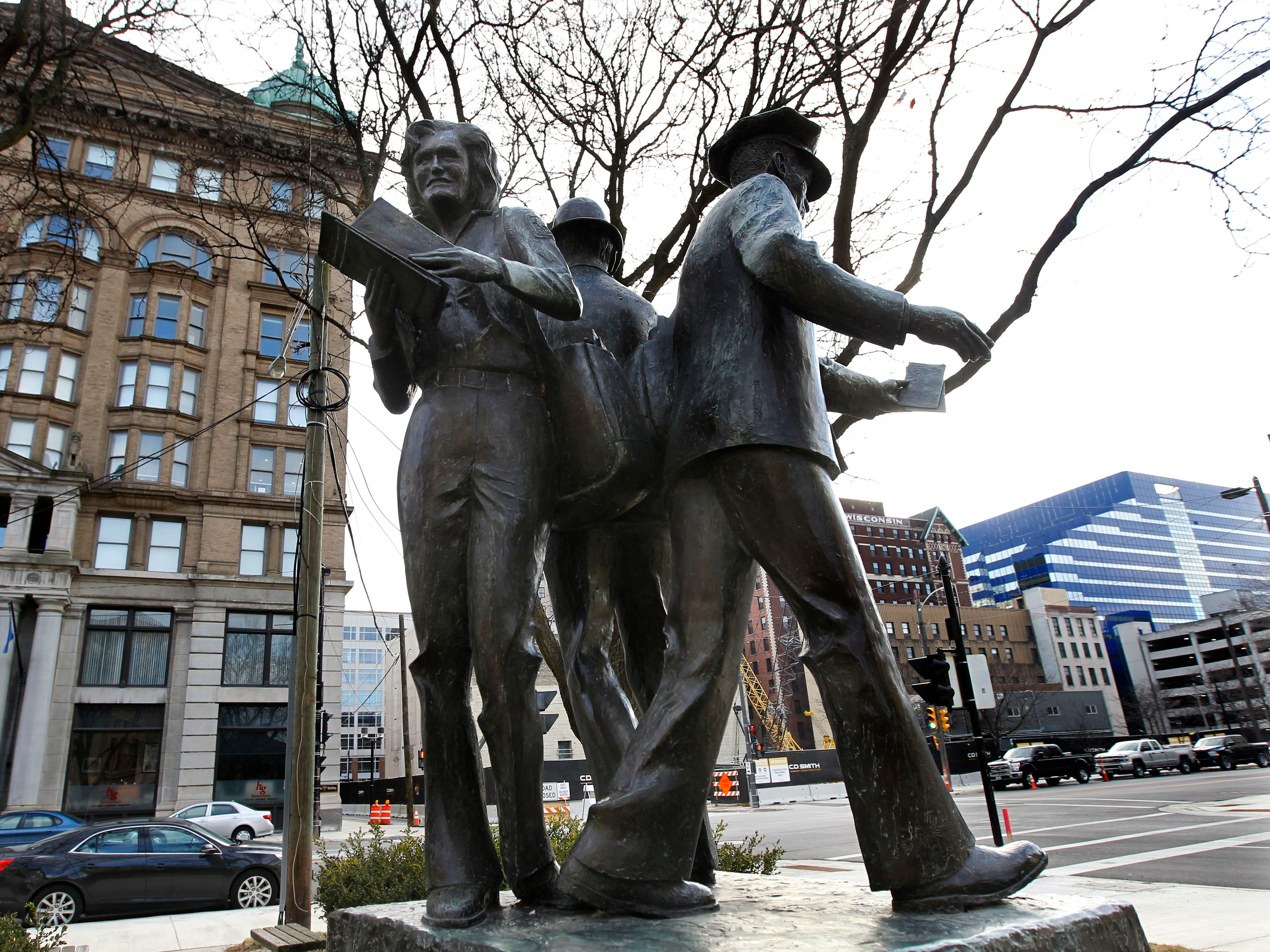 A statue honoring the work of letter carriers is seen on Plankinton Avenue in Milwaukee.