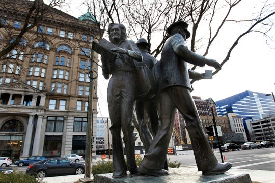 This statue honoring the work of letter carriers is at Plankinton Avenue and Wells Street in Milwaukee. A woman letter carrier is featured on the left.