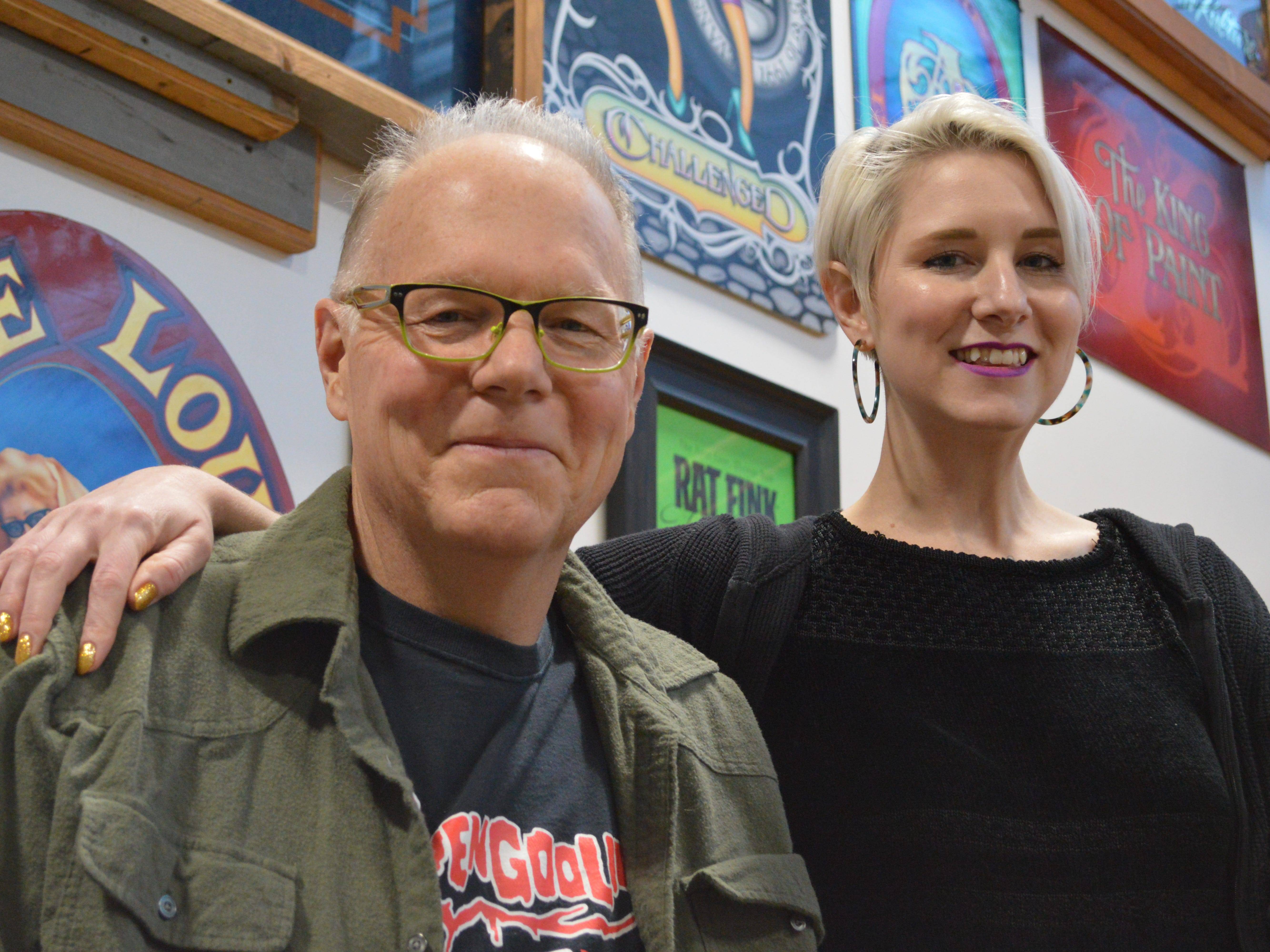 Danielle Williams-Szydel is learning sign painting from her dad, Jeff Williams.