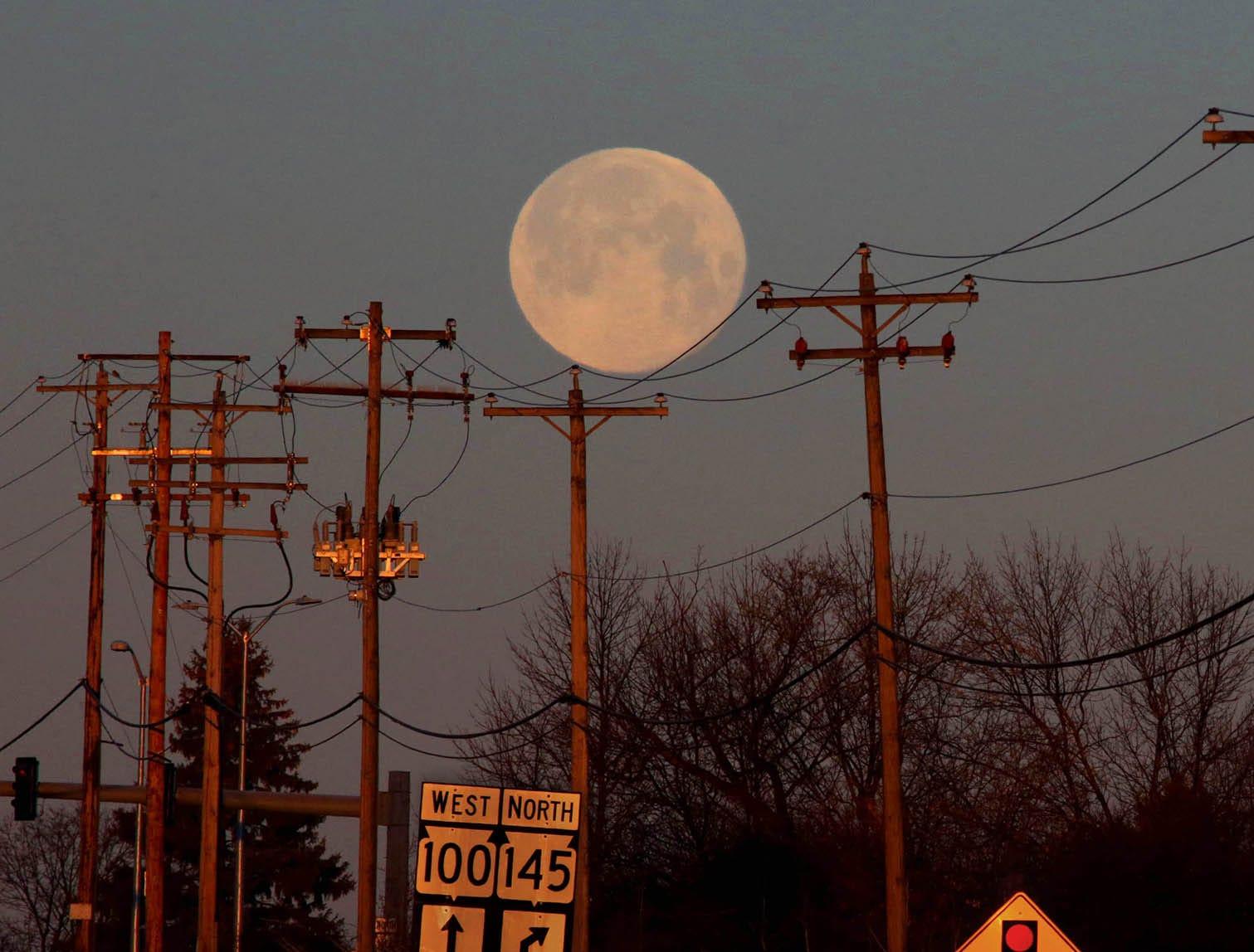 The nearly full moon is seen just before sunrise on West Brown Deer Road in Brown Deer March 2, 2018.