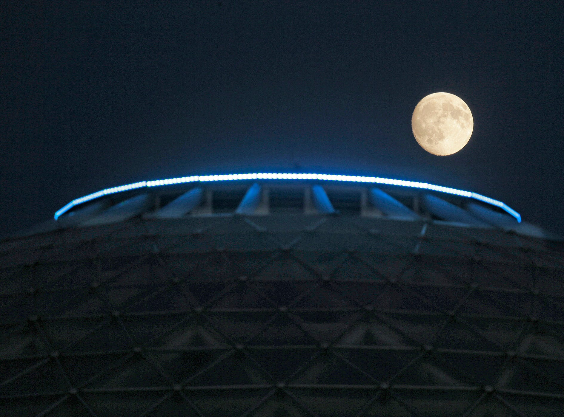 The moon rises over the the Domes at the Mitchell Park Conservatory in Milwaukee Sept. 14, 2016.