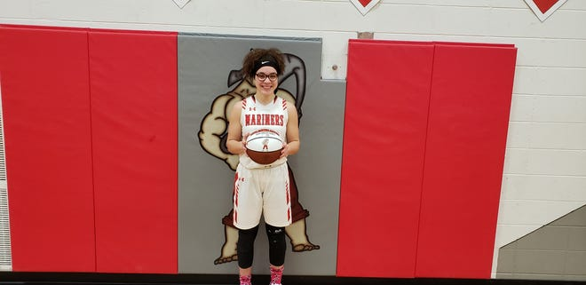 St. Francis senior Kiara Redman-Trotter poses with a basketball she received after scoring her 1,000th point Jan. 5, 2019