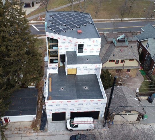 Several solar panels are seen on the roof from the rear of a home being built for Ald. Tony Zielinski.