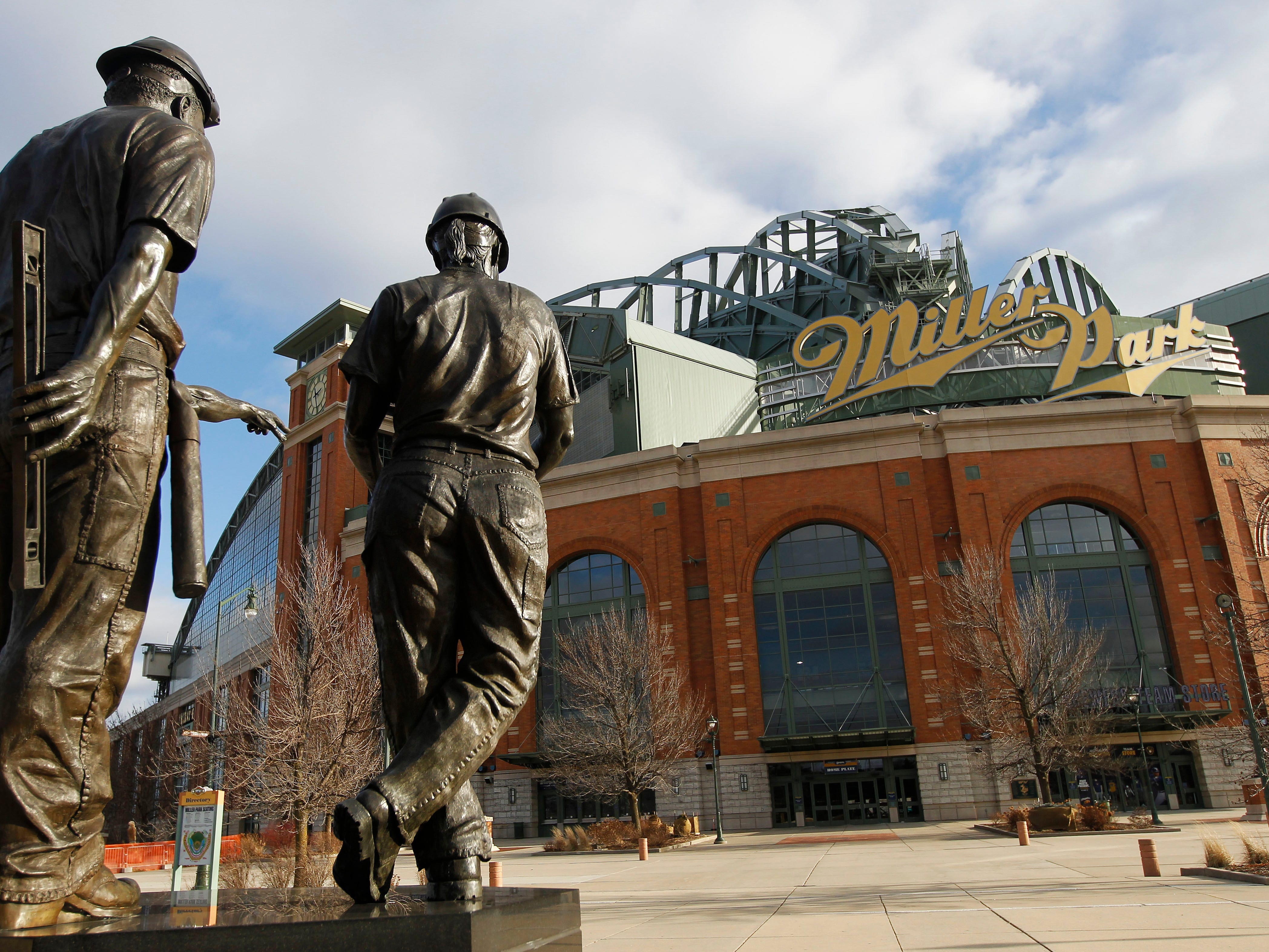 "A statue titled ""Teamwork"" at Miller Park shows a woman on the right."