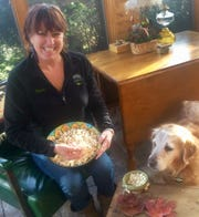 Popcorn lovers Joanie Hawley and Kahlua the Golden Retriever enjoy popcorn any time of the day, even for breakfast.