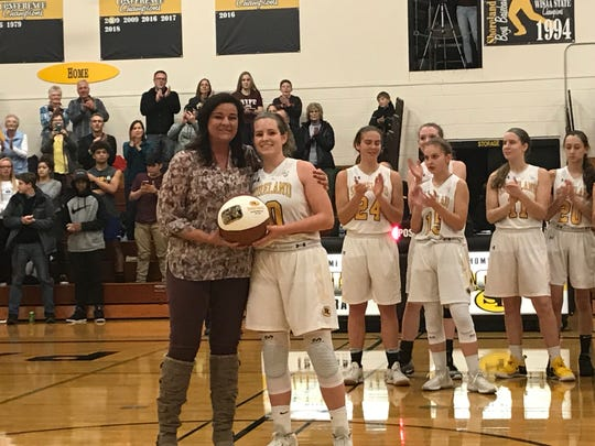 Shoreland Lutheran's Chelby Koker (right) poses with coach Holly Bahr after scoring her 2,00th point during the team's victory over Kenosha St. Joseph Tuesday Jan. 8, 2019.