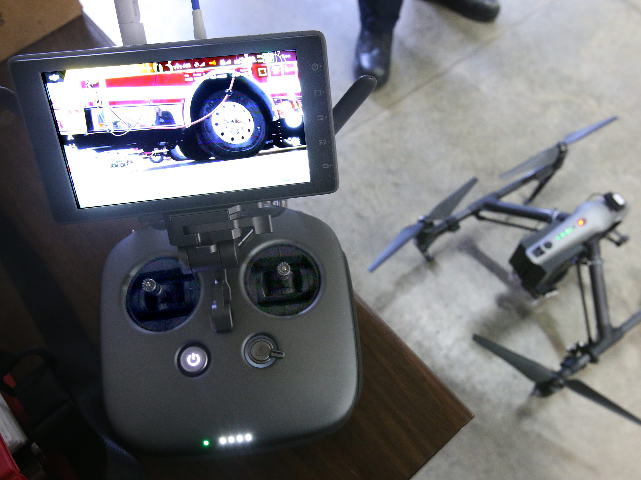 The Merton Fire Department drone controller with real-time high-definition video from one of the drone's two cameras. A second operator monitors tablet receiving imaging from the drone's infrared camera.