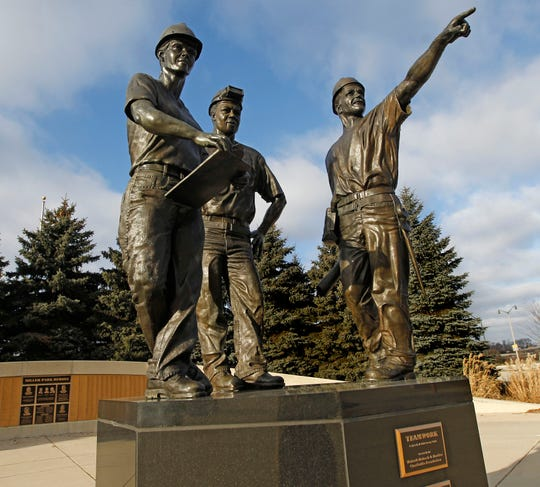 "A statue titled ""Teamwork"" at Miller Park includes a woman (left)."