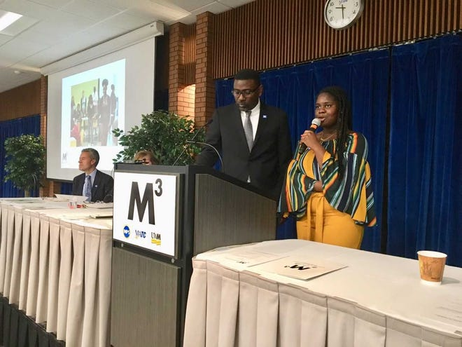 Mawah Kromah, a graduate of Milwaukee's James Madison High School, talks about the M-cubed summer bridge program that helped her make the transition from MPS to the University of Wisconsin-Milwaukee. The program is among a number of supports in place to help MPS students succeed in college. Also pictured are MPS Superintendent Keith Posley (center) and UWM Chancellor Mark Mone (left).