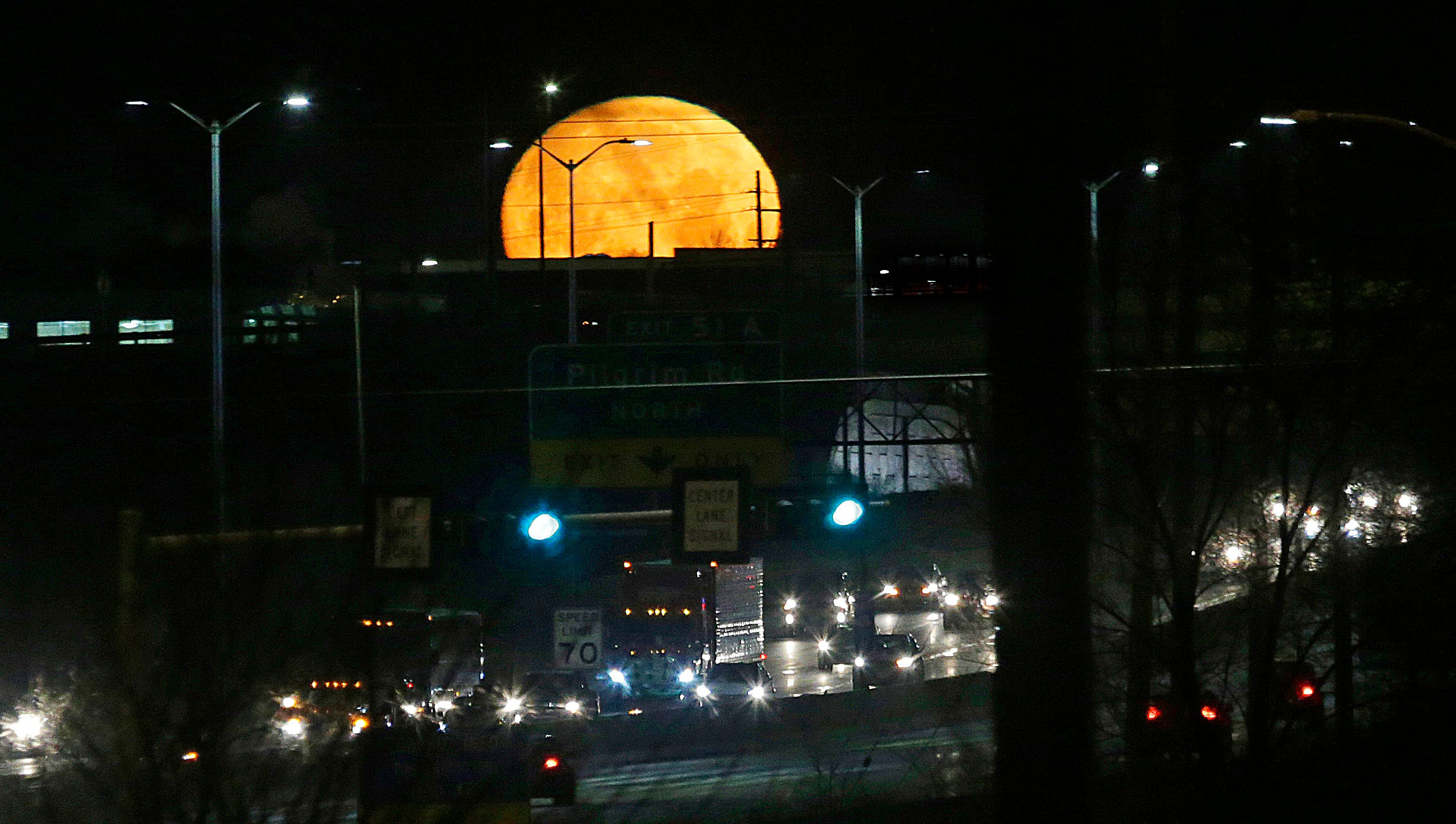The nearly full super moon sets over State Highway 41/45 near Pilgrim Rd. In Menomonee Falls, WI on Tuesday, January 30, 2018. The actual super blood blue moon total eclipse on Wednesday could be eclipsed by clouds.   - Photo by Mike De Sisti / Milwaukee Journal Sentinel ORG XMIT: MJS1801300755080002