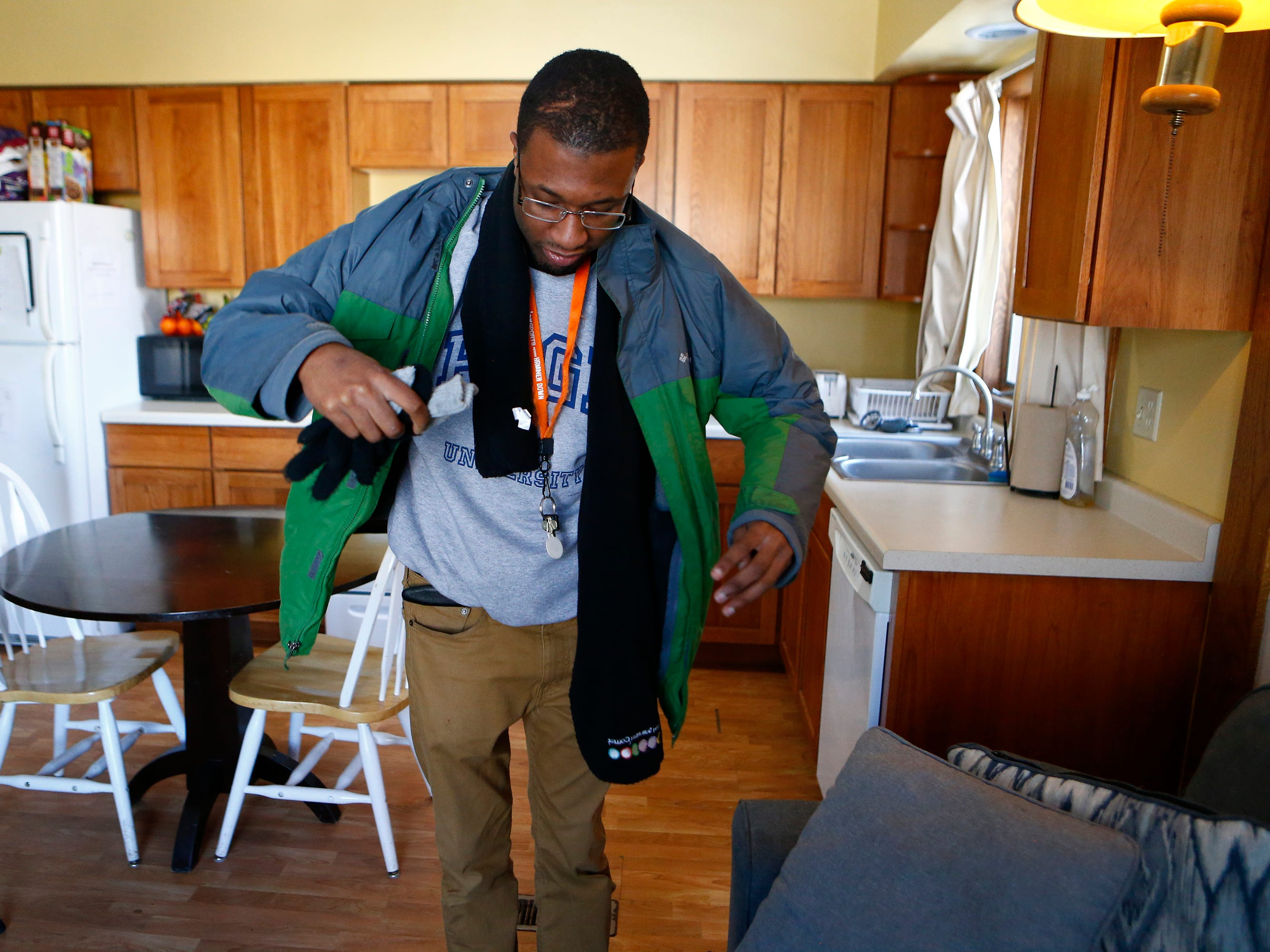 Ben Page readies to leave his apartment to go work at his internship at Sheperds College, a school for students with intellectual disabilities, in Union Grove.