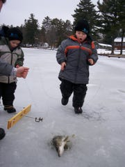 Anthony Chentis' grandsons Dylan (left) and Nate Cleveland enjoy ice fishing. Chentis and fellow Sons of the Watertown American Legion Post 189 member Tony Dittmann are inviting others to learn and enjoy a day on Lower Genesee Lake on Saturday, Jan. 19.