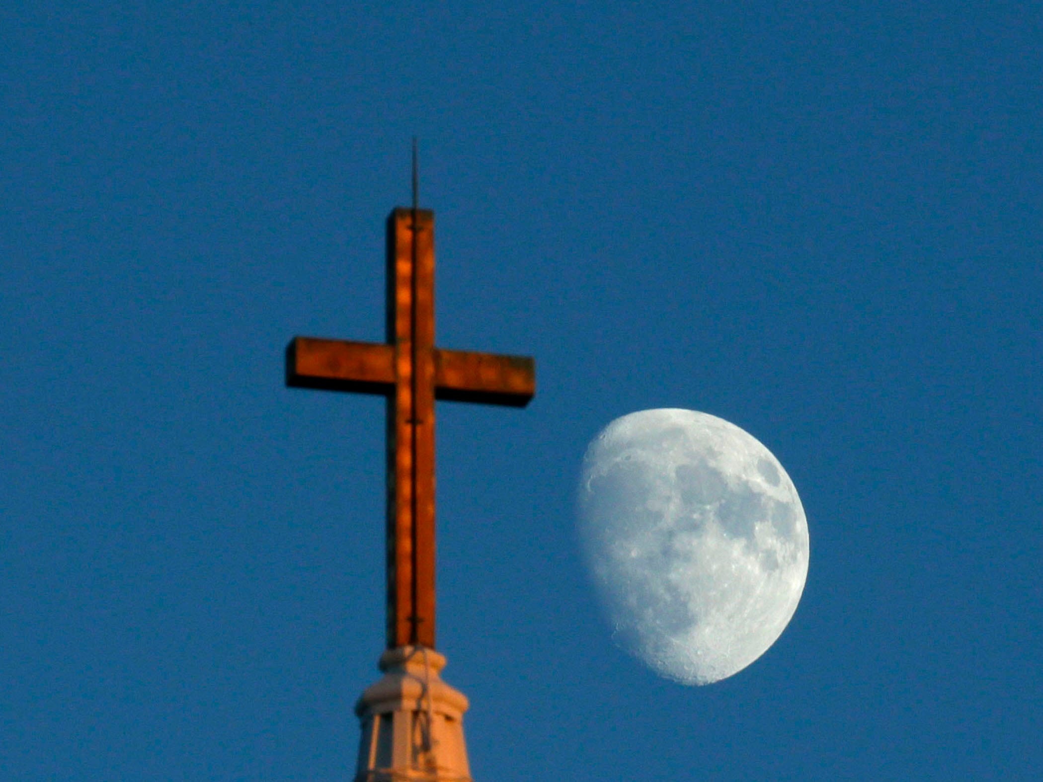 The moon rises over St. Christopher's Episcopal Church in River Hills on Nov. 30, 2017.