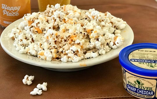 Wisconsin Cheese Popcorn is a warm, rich and salty treat.