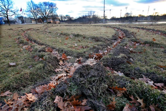 Vandals left deep ruts by driving in a McCarty Park field between the park's lodge and West Arthur Avenue.