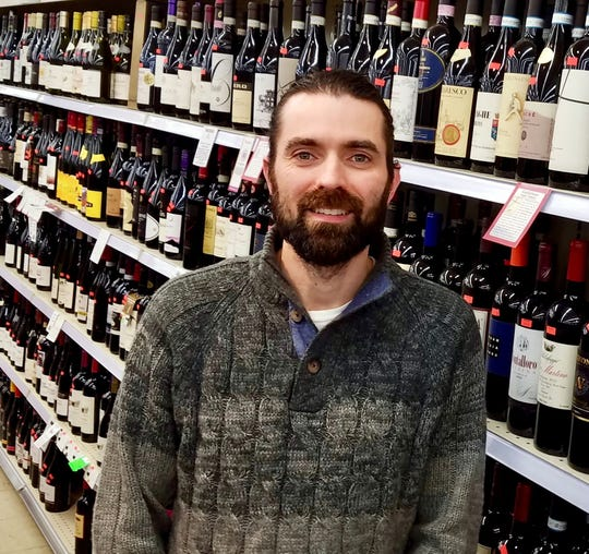 Tom Greguska, co-owner of Discount Liquor, recommends a variety of beer, wine and alcohol-free beverages, some locally made, to enjoy with homemade popcorn.