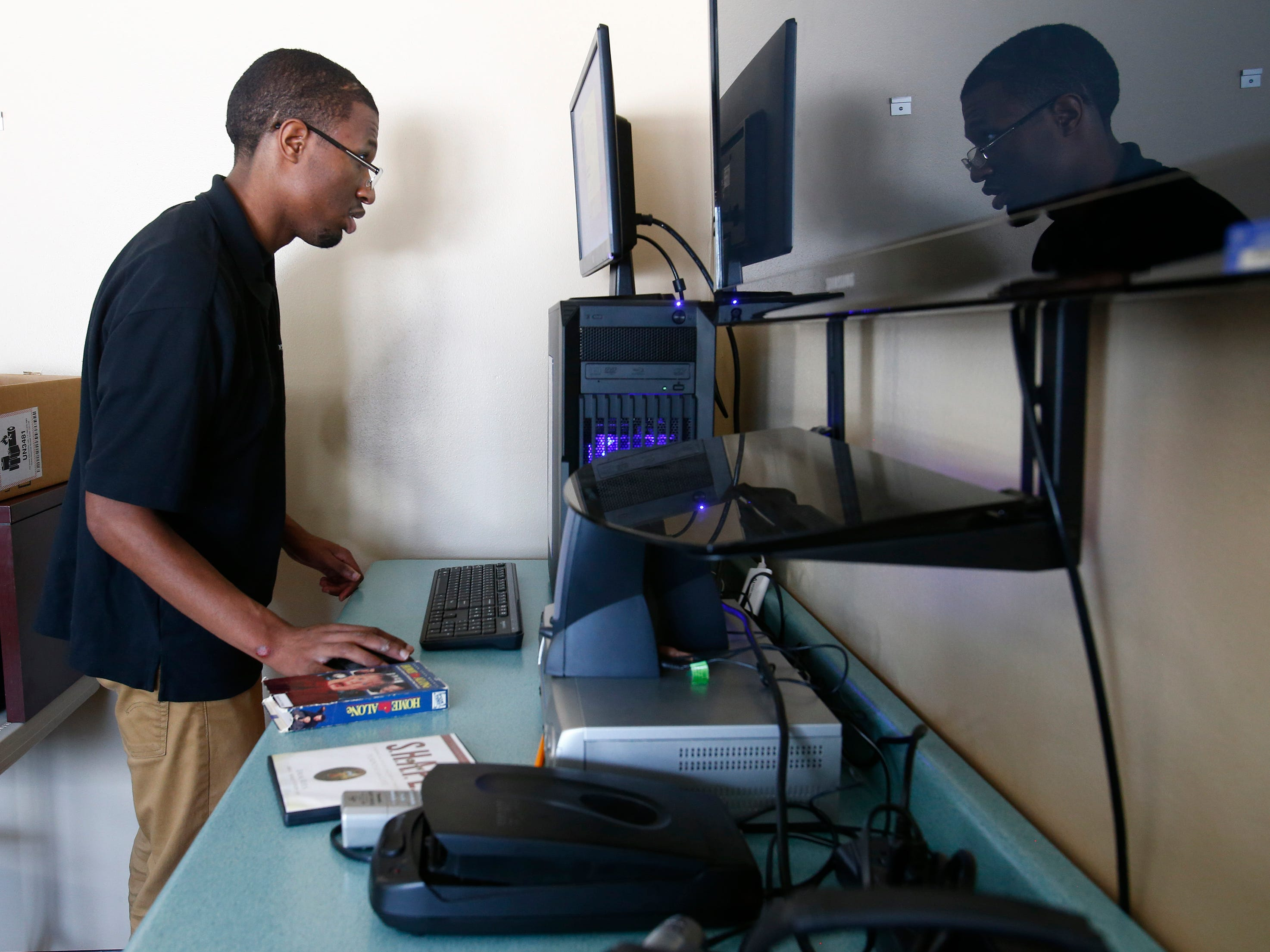 Ben Page works at his internship in the technology area while attending Shepherds College, a school for students with intellectual disabilities, in Union Grove.