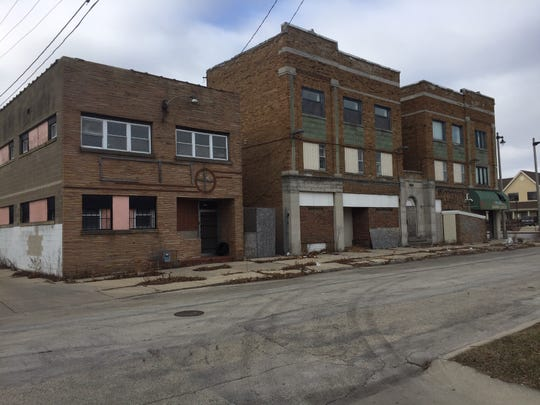 Two adjacent buildings on Milwaukee's north side to be redeveloped into a jobs training center (left) and remodeled apartments and retail space (right).