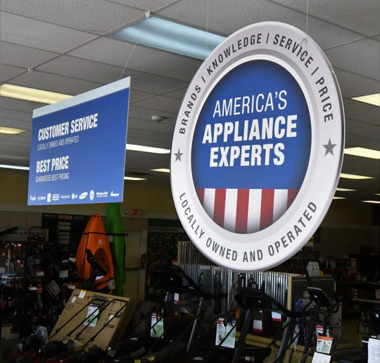 Signs denoting that the Sears Hometown Store in Mountain Home is locally owned and operated hang above the sales floor Tuesday afternoon.
