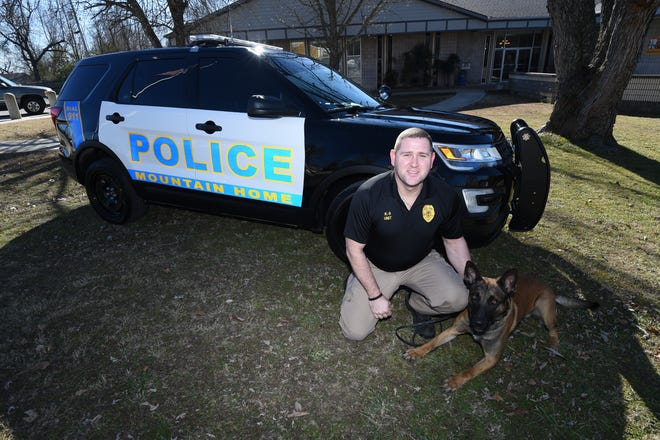 Sgt. Jonathan Griffin and his canine partner Harmon will be getting one of the the Mountain Home Police Department's new Ford Explorers. Harmon, a 75 pound Belgian Malinois also is new to the department.