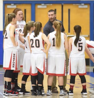 Norfork coach Josh Laymon instructs his team during a timeout in a recent game.