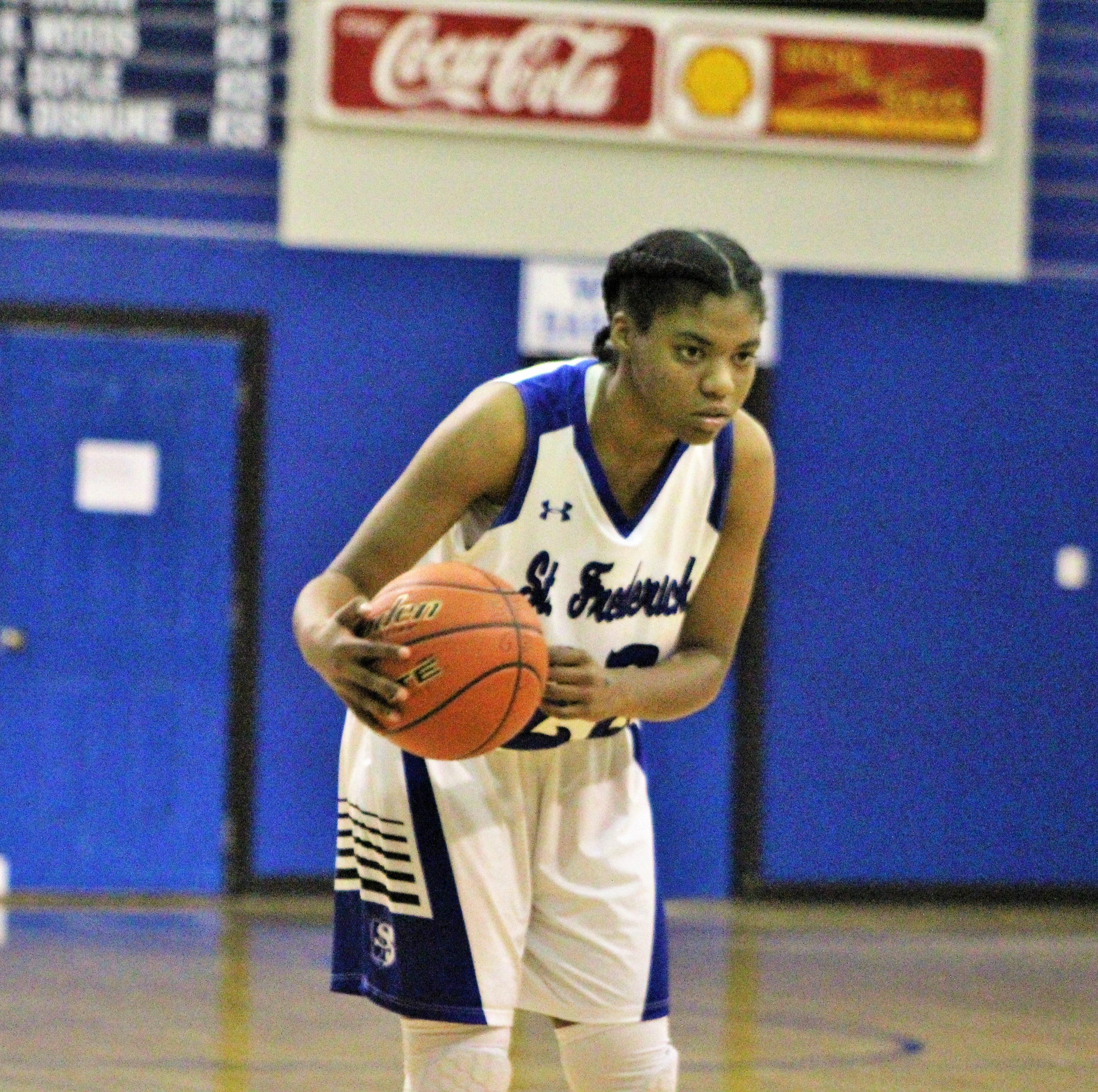 St. Frederick freshman Pashonnay Johnson (22) gets ready to move the ball up-court against Oak Grove in the Lady Warriors' 71-63 District 2-1A win at St. Frederick's Monseigneur Marsh Memorial Gym on Tuesday. Johnson scored 34 points to lead all scorers in the Lady Warriors' victory.