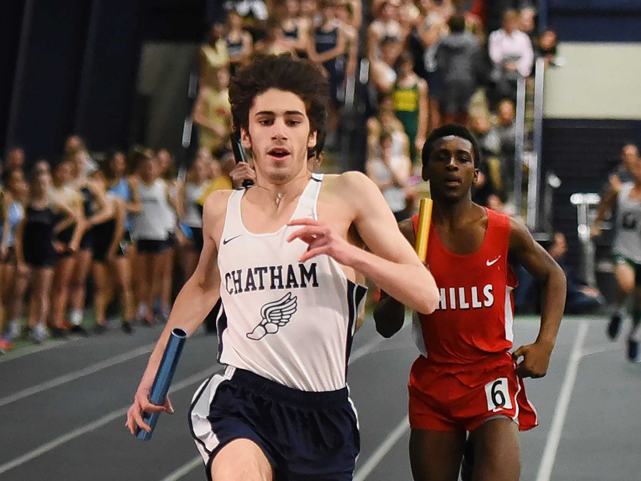 Sam Viola of Chatham crosses the line first in a heat of the 4x200 at Morris County Relays at Drew University in Madison on 01/09/19.