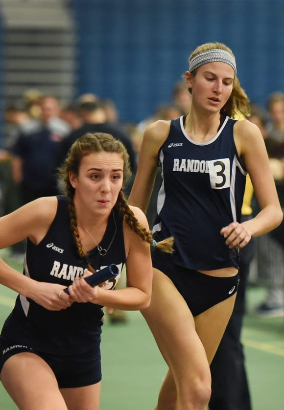 Meredith Finley (R) of Randolph hands off the baton to teammate Claire Doto during the distance medley at Morris County Relays at Drew University in Madison on 01/09/19.