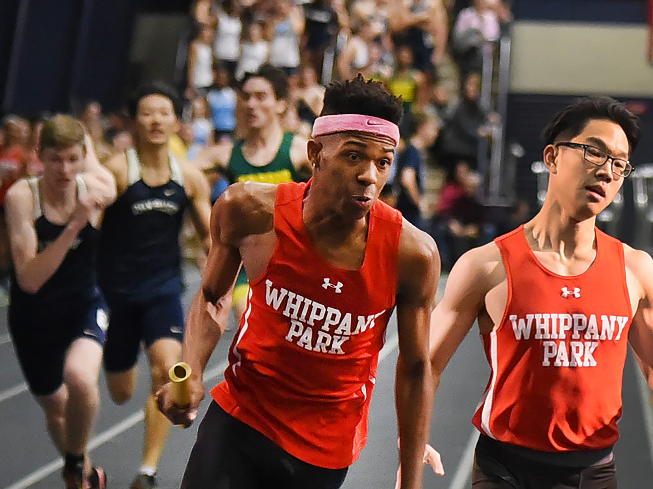 Whippany Park senior Christian Martin, who plans to run at Cornell, carries the baton to victory during the 4x200 at Morris County Relays at Drew University in Madison on 01/09/19.