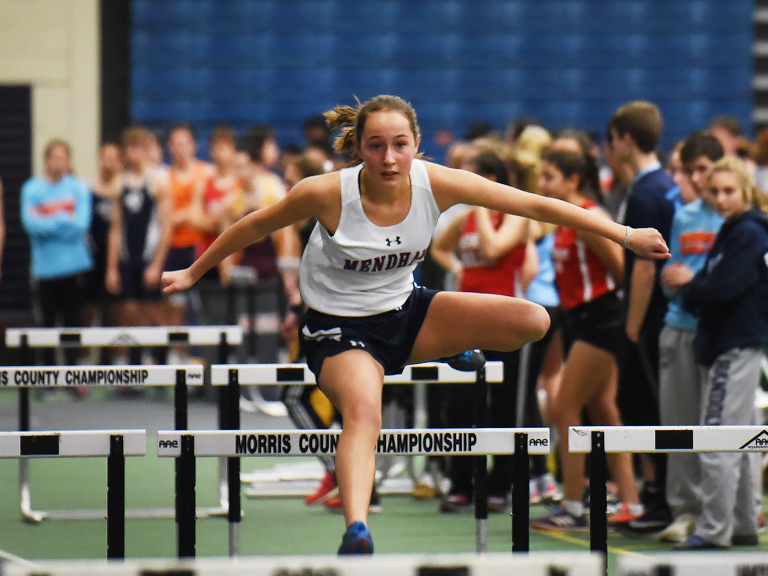 Silje Debets of Mendham clears a hurdle during Morris County Relays at Drew University in Madison on 01/09/19.