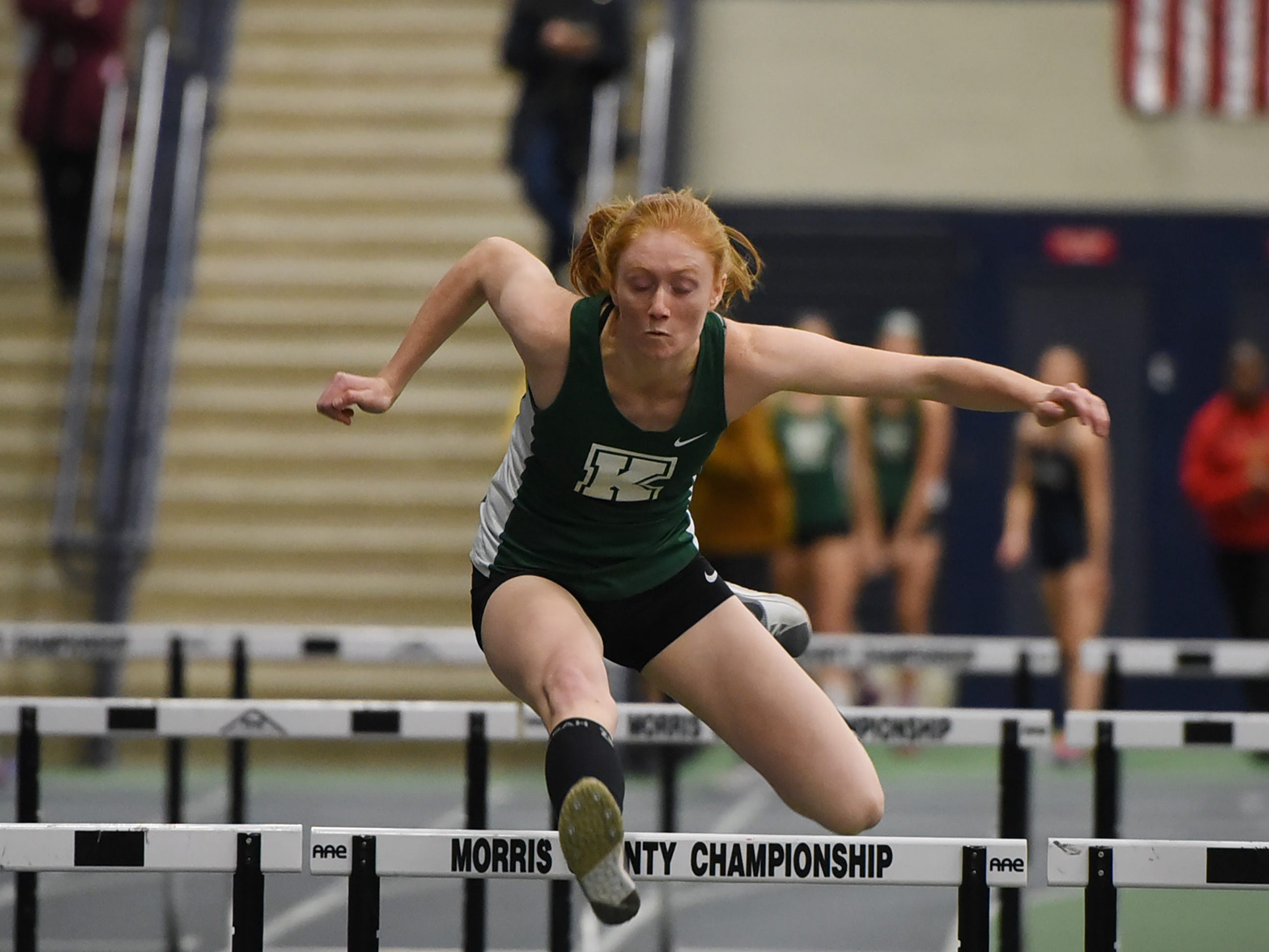 Kathryn Brown of Kinnelon clears a hurdle on the final leg of the shuttle hurdles at Morris County Relays at Drew University in Madison on 01/09/19.