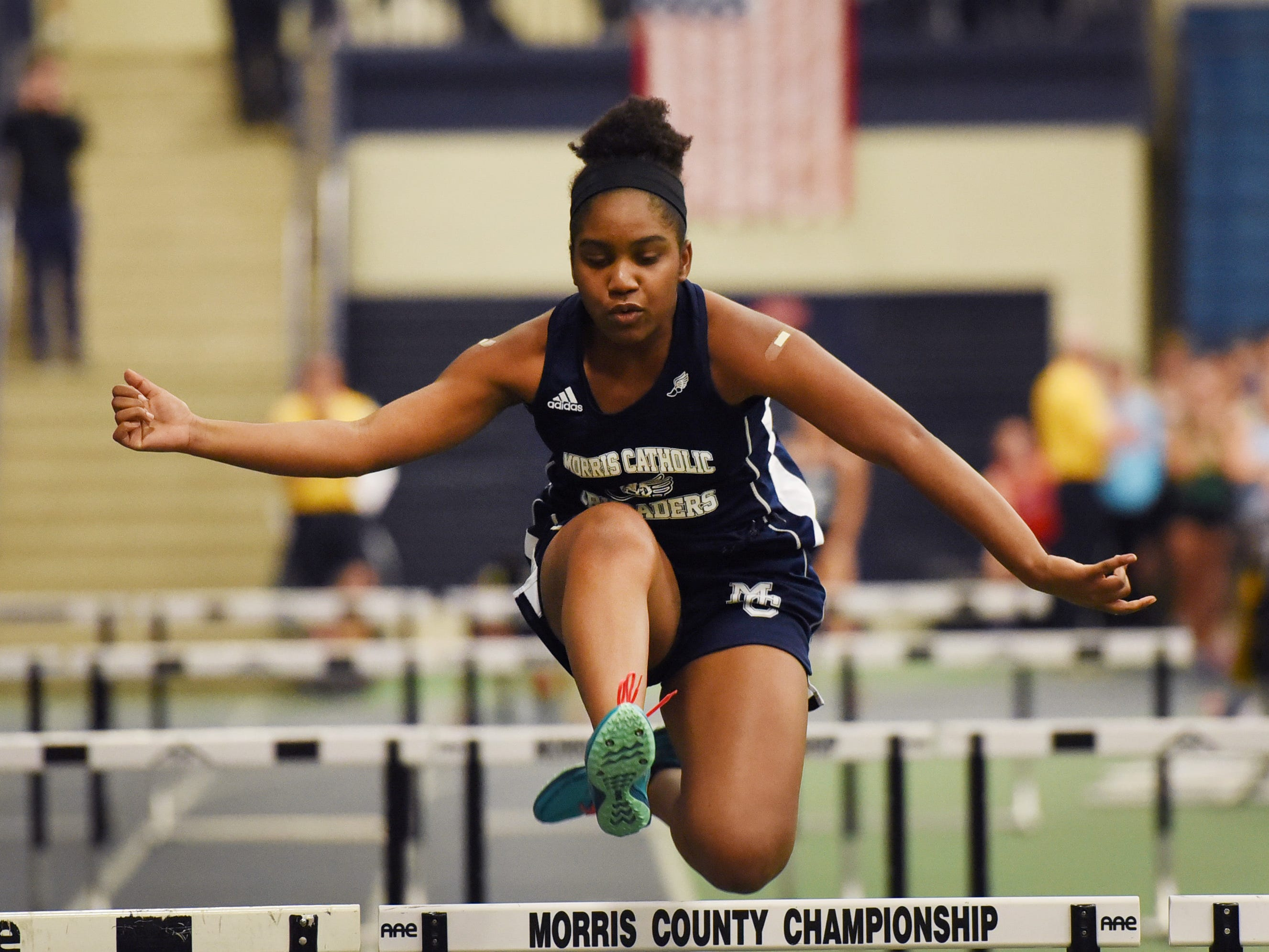 Morris Catholic sophomore Sidney Enemuo clears a hurdle during Morris County Relays at Drew University in Madison on 01/09/19.