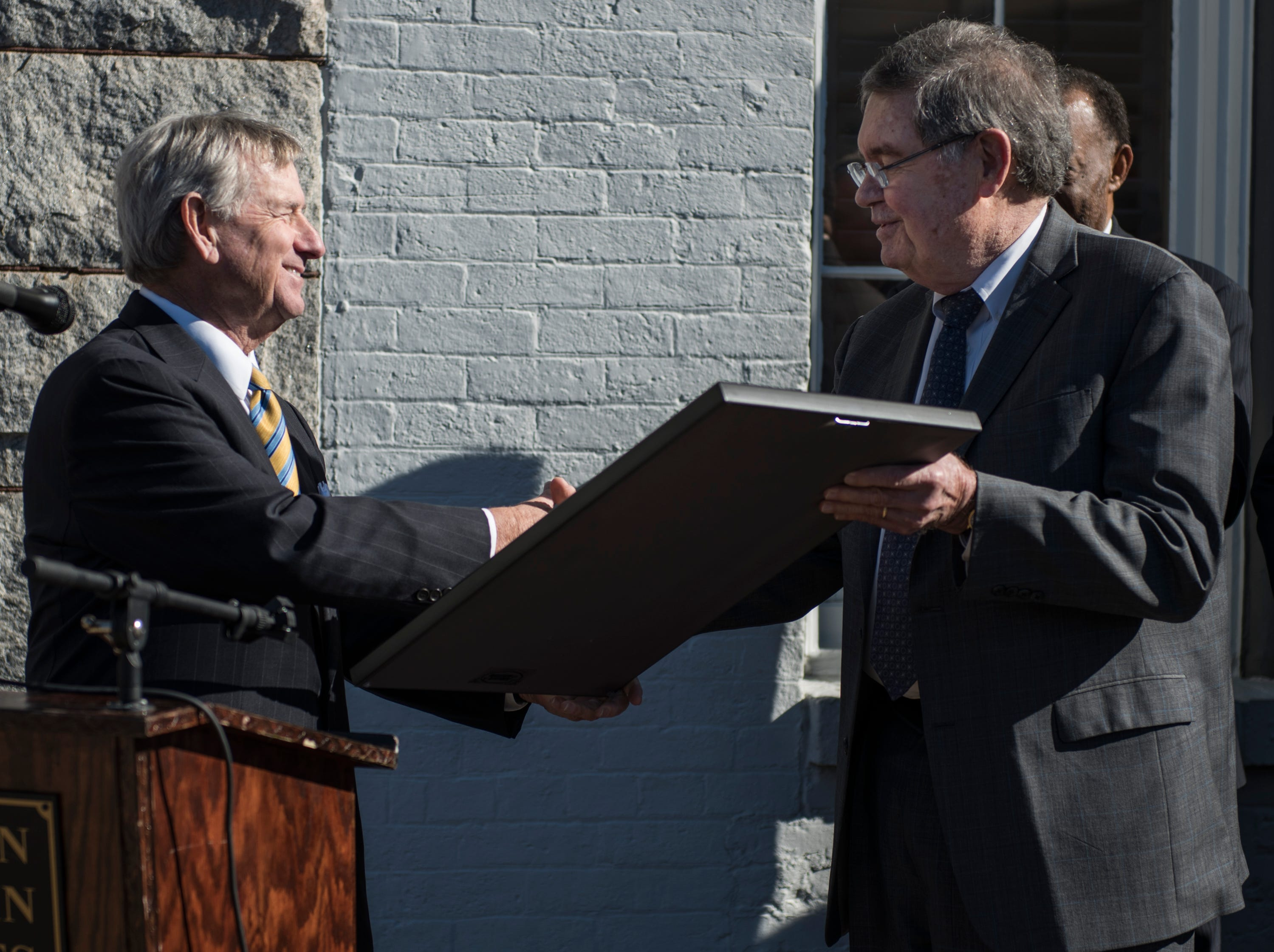 Mayor Todd Strange awards a key to the city to Jere Beasley during the Beasley Allen law firm 40th anniversary celebration in Montgomery, Ala., on Wednesday, Jan. 9, 2019.