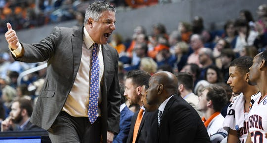 Auburn head coach Bruce Pearl talks to the players on the bench during the second half of an NCAA college basketball game against North Florida Saturday, Dec. 29, 2018, in Auburn, Ala.