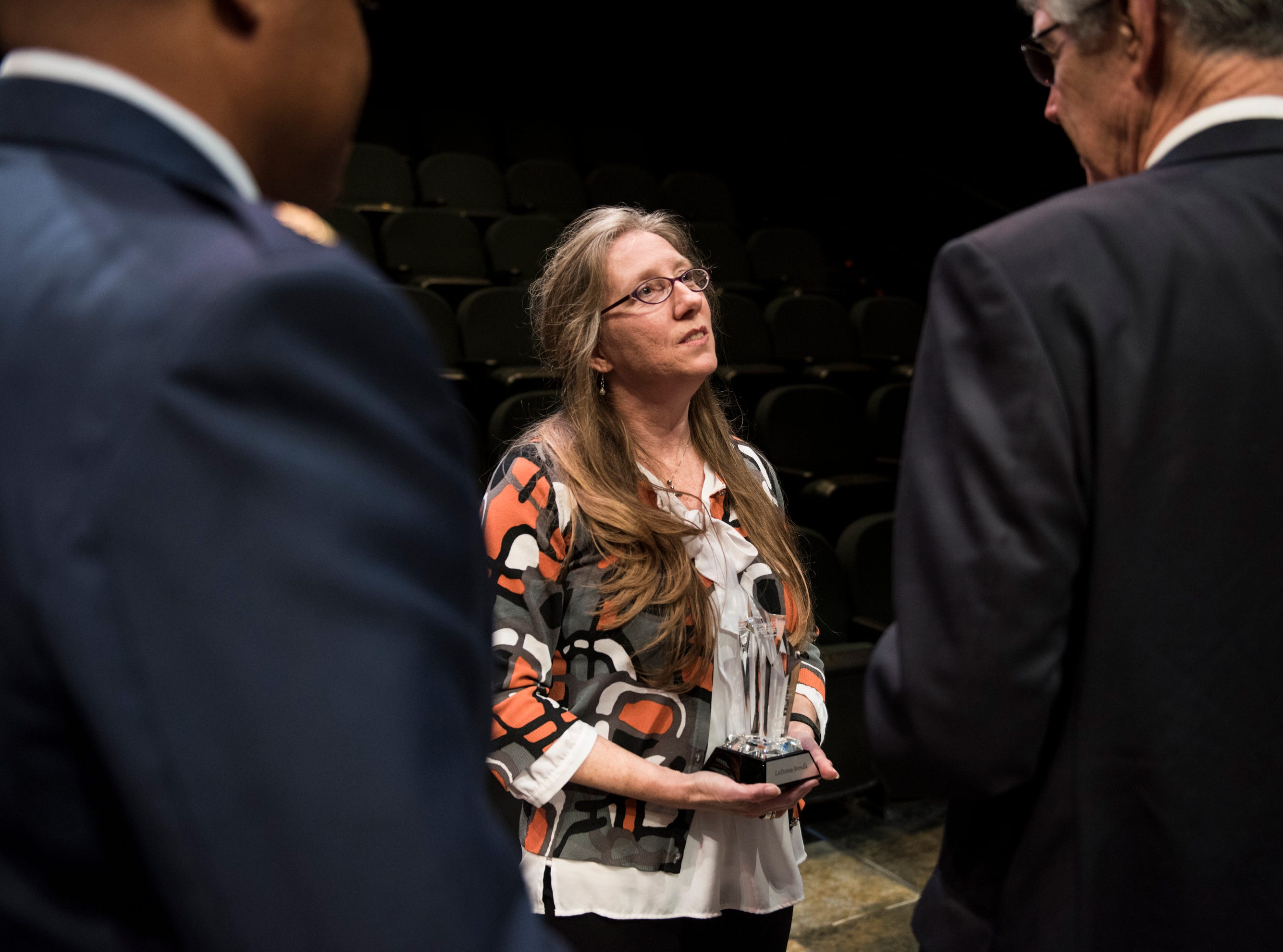 Community Hero of the year LaDonna Brendle speaks with other heroes during the Community Heroes awards ceremony at Alabama Shakespeare Festival in Montgomery, Ala., on Tuesday, Jan. 8, 2019.