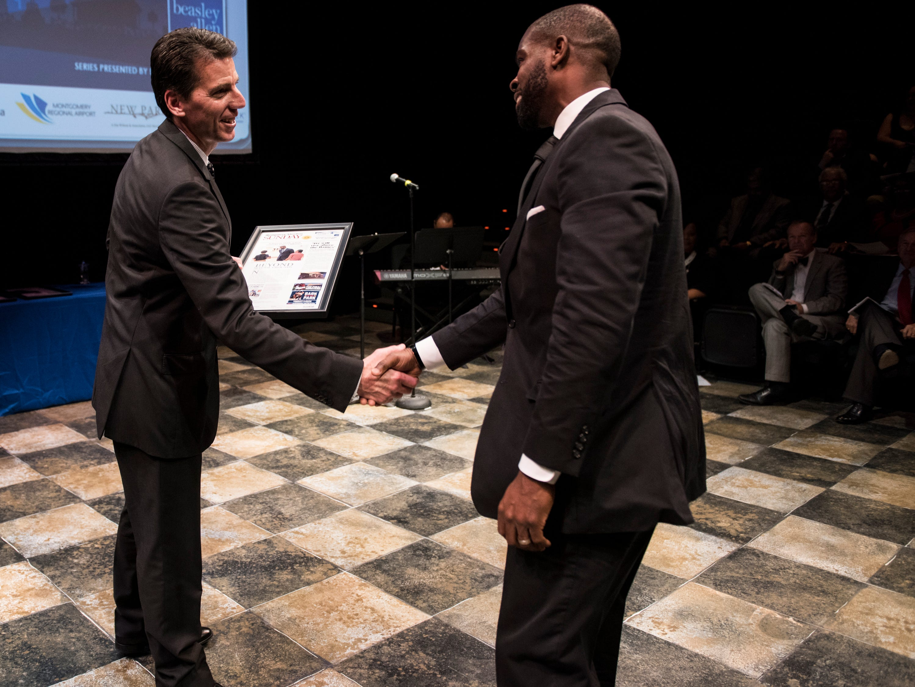 Montgomery Advertiser publisher Michael Galvin awards Thomas Tullis during the Community Heroes awards ceremony at Alabama Shakespeare Festival in Montgomery, Ala., on Tuesday, Jan. 8, 2019.