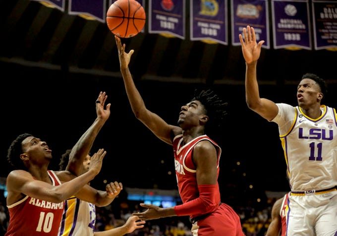 Jan 8, 2019; Baton Rouge, LA, USA; Alabama Crimson Tide guard Kira Lewis Jr. (2) shoots over LSU Tigers forward Kavell Bigby-Williams (11) during the first half at the Maravich Assembly Center. Mandatory Credit: Derick E. Hingle-USA TODAY Sports